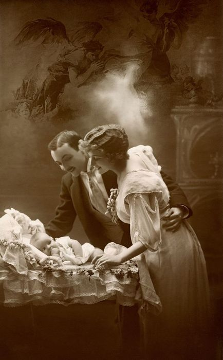 Vintage photo of sweet baby and adoring parents circa 1920 -1930.