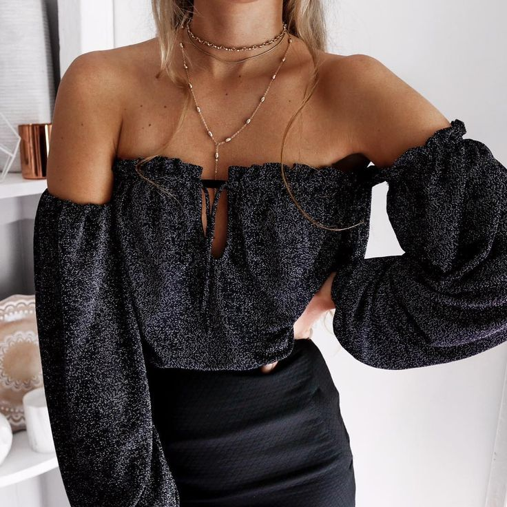 layered necklaces + black outfit