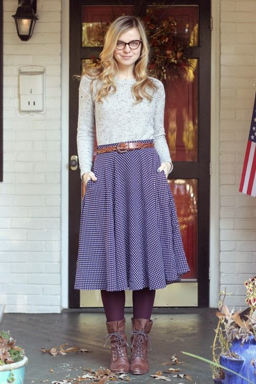 Grey sweater, blue polka dot midi skirt, dark purple tights, brown belt and boots