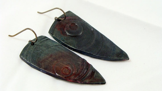 Polymer clay tribal earrings, stamped and highlighted with alcohol inks and powders.