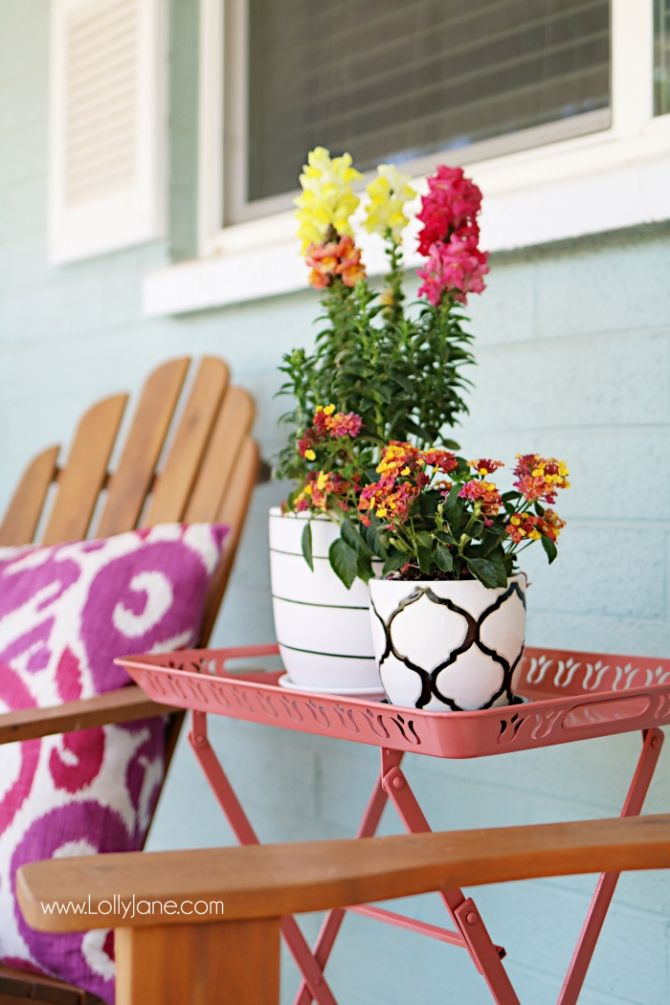 Fresh porch decor ideas! Love the pops of coral and bright summer colors! New vases with colorful flowers really brighten up this porch! Great, easy porch decor ideas! #AtHomeFinds #ad #homedecor #outdoorliving