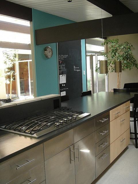 IKEA kitchen in an Eichler home. Love the turquoise wall + chalkboard. #midcentury #designpublic