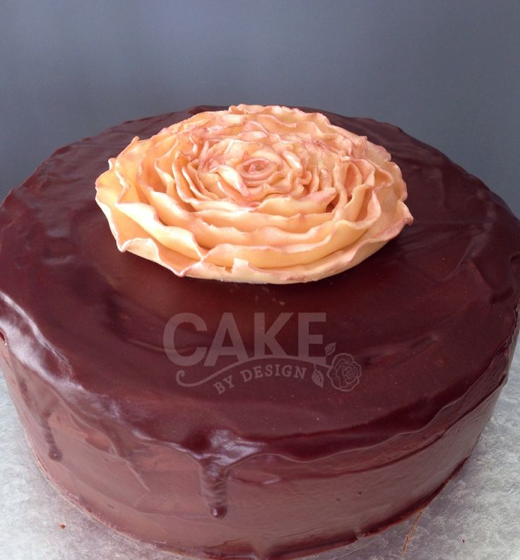 Rich moist dark Lindt chocolate ganache with a Lindt modeling chocolate handmade ruffle rose topper www.cakebydesign.co.za