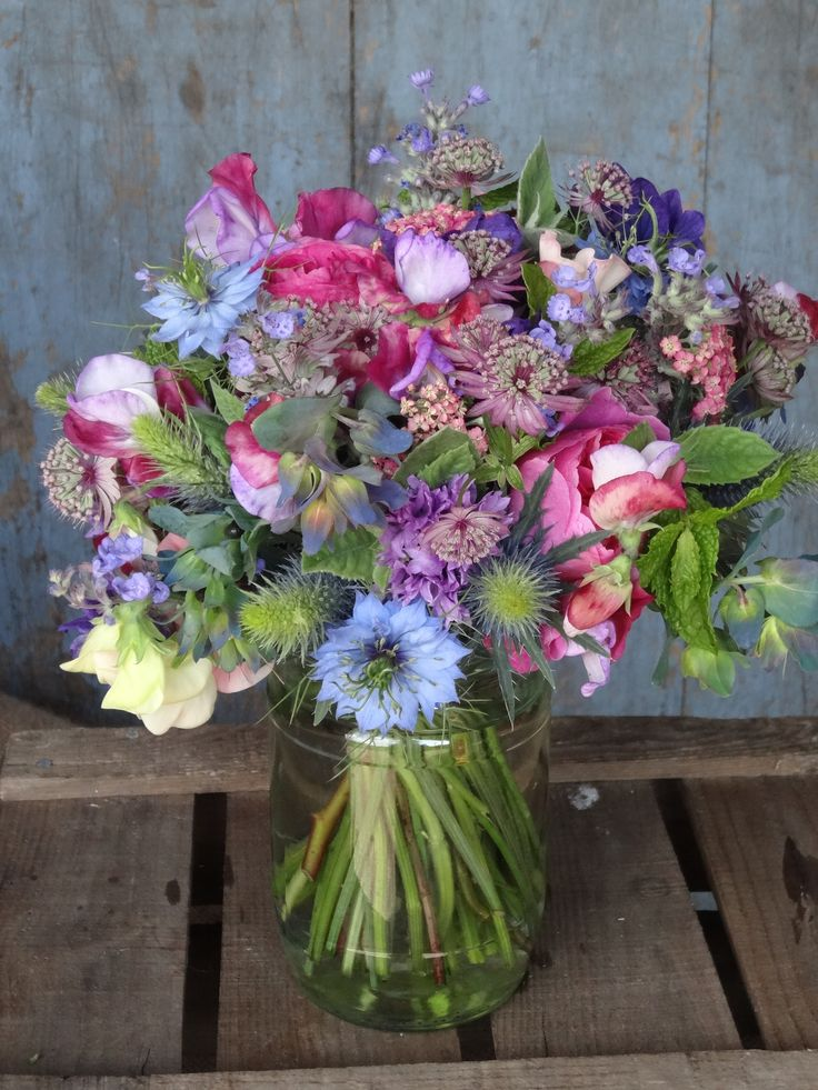 June wedding flowers by Catkin www.catkinflowers.co.uk   This kind of style and colours Helen?  A lot of these flowers are still available in July.