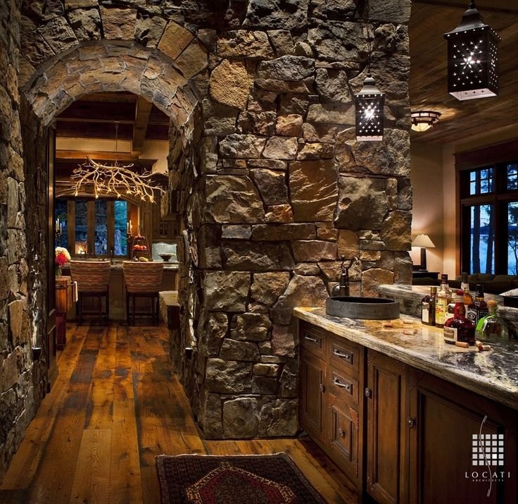 Eclectic Bar with Interior stone wall, Pendant light, Bagatelle chandelier from allan-knight.com, Pendant, Hardwood floor