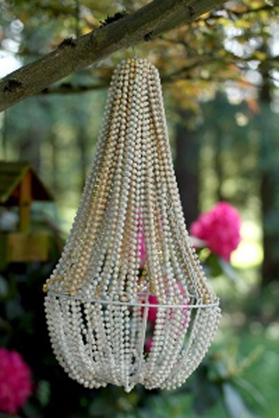 1$ chandelier   you need a hanging basket beads hot glue gun and wire.  You can buy spray paint to paint the beads a more vintage color and use this as your new lighting fixture :)