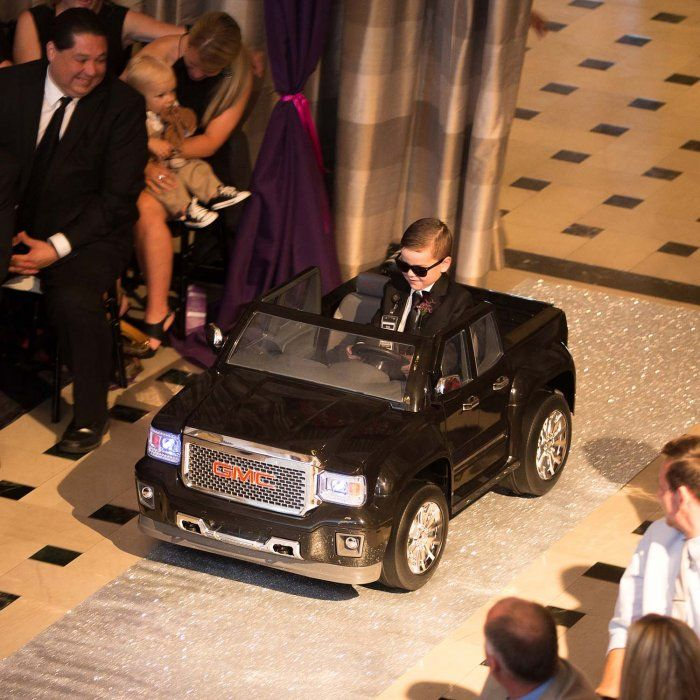 This ring bearer drove a mini SUV down the aisle!