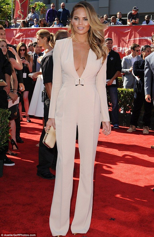 Glam: The stunning model wowed on the red carpet on Thursday evening in a pale pink jumpsuit with plunging neckline as she attended the ESPYS in Los Angeles