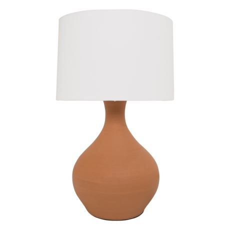 Fall in love with the soft curves of this Mediterranean-inspired lamp. Simple enough to match your existing theme, this lamp won't take over your space but will add subtle elegance. The natural earthy tone of the matte terracotta base and simple white shade are a match made in heaven. Light up your living room or family room with the beautiful glow of this versatile lamp it's the perfect fit for side tables, consoles and just about anywhere you need to add a little extra light and the…
