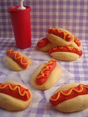 Hotdog Cookies 1 c butter 1/2 c icing sugar 1 tsp vanilla  2 c flour red food colouring Cream together butter,  sugar and vanilla until light and fluffy. Stir in the flour until smooth.  Into 1/3 of the mixture add red food colouring to make dogs. Chill 1 hr. Divide into 14, roll into logs. Make bun shapes with remaining dough, make a groove in centre, place in dog.  Bake 350 12-14 min.  Ice with red and yellow (1c icing sugar, 1tbsp meringue powder, water, colours)