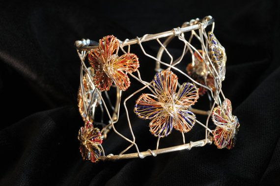 Flower bracelet, orange blue, wide bracelet, solid silver bangle, wire sculpture, modern art jewelry, hippie, Christmas, bridesmaid gift  Handmade bracelet, made of colored copper wire and silver. Dimensions of the wire sculpture, art bracelet, floral jewelry are 18cm (7.09in) the region, and 4.5cm (1.77in) the height. The modern, hippie, chic, Christmas, bridesmaid bracelet gift, spring wedding jewelry, made from silver 9.25. The flowers are made of colored copper wire and silver.