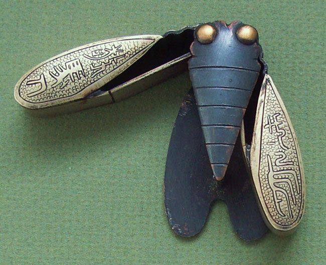 Antique cicada inkwell