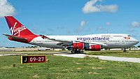 Virgin Atlantic Airways (UK) Boeing 747-400 G-VROY aircraft, named ''PRETTY WOMAN- from a comedy film'' & ''Britain's Flag Carrier'', skating at Barbados Grantley Adams International Airport. 03/12/2016.