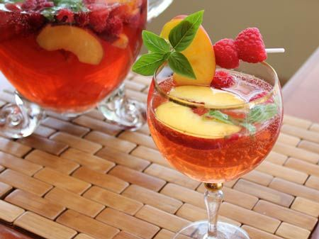 Basil, Peach and Raspberry Summer Sangria  Posted by Cooking with SugarThe fresh taste of basil goes so well with the peach and raspberries that it's a guaranteed crowd-pleaser.
