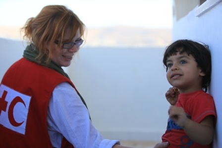 Red Cross Volunteer Rita entertains a child living in Ajloun, Jordan.    Tens of thousands of Syrians have taken refuge in neighbouring countries, such as Lebanon, Jordan and Turkey after fleeing the fighting. Some are injured and in need of medical attention. Others are simply exhausted and vulnerable. Most refugees could bring virtually nothing with them as they crossed the border.