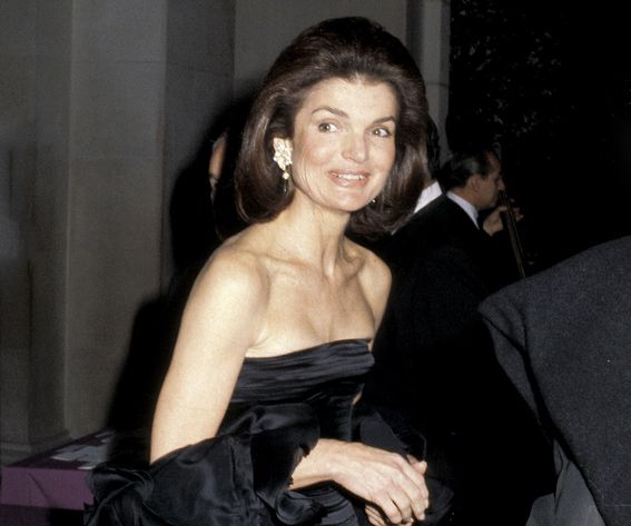 """Jackie: A Legacy of Style - December 3, 1979. In a black strapless gown at the Costume Institute Gala Presents """"Fashions of the Hapsburg Era"""" at the Metropolitan Museum of Art."""