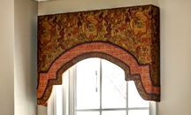 Arched upholstered cornice contrast banding floral fabric foyer