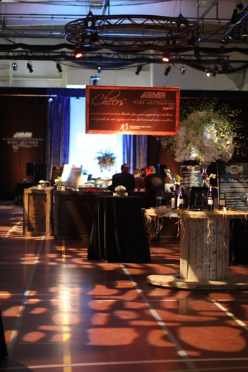 Cobblestone gobos helped to disguise the gymnasium floor as guests entered.