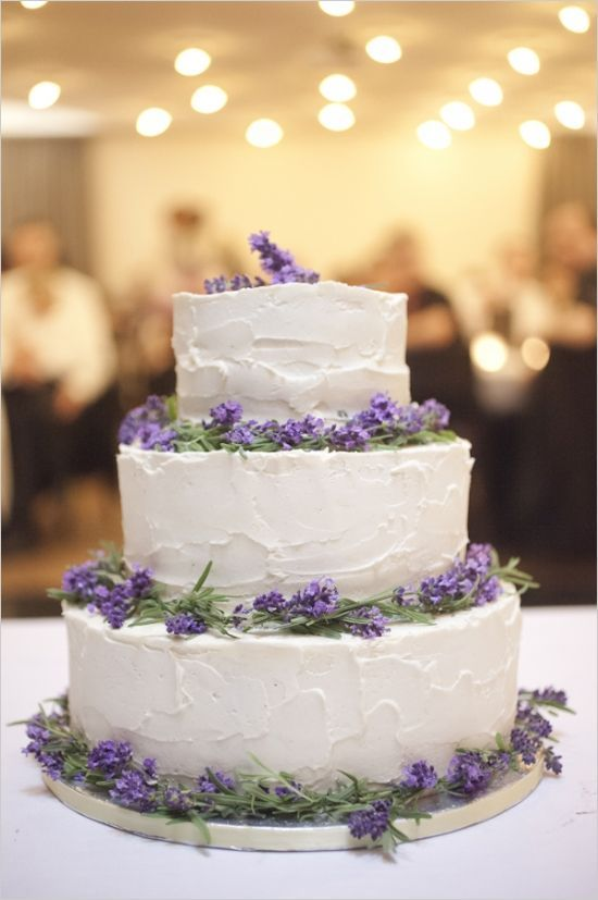 white wedding cake and lavender accents #weddingcake #tieredweddingcake #weddingchicks http://www.weddingchicks.com/2014/03/19/lavender-and-silver-switzerland-wedding/: