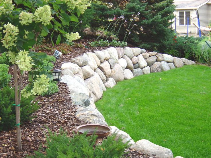 Boulder wall idea for backyard