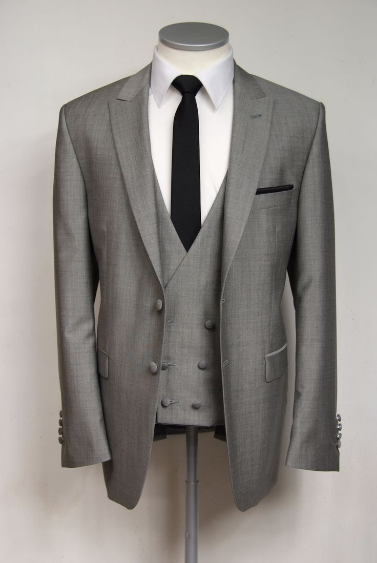 Grooms wedding suit  Silver mohair mix slim fit suit with low cut db waistcoat.  Made to measure white cotton shirt and knitted silk black tie.  £645.00  3 piece