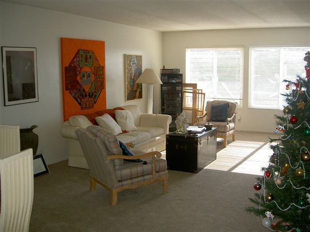 living room in 2bdrm with view of beach, surf, sunsets