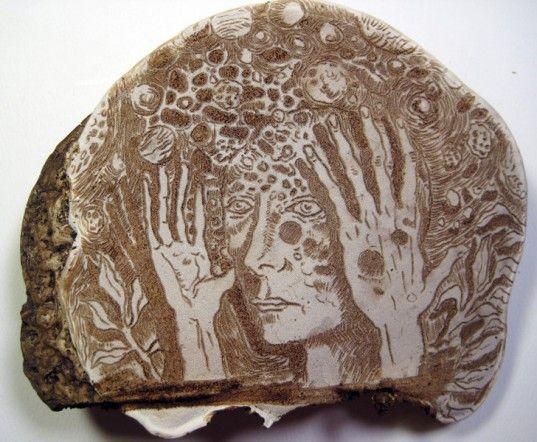 Corey Corcoran delicately etches designs into fungi.