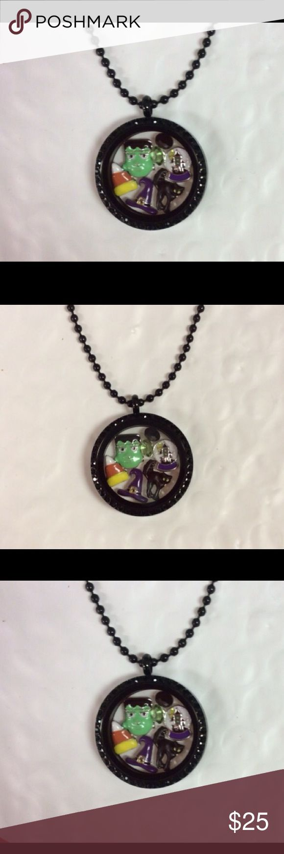 Origami Owl style locket and Halloween charms BOO This is a black stainless steel locket 30 mm. Inside you will get Halloween charms me not be this exact thank you have a great day. I am running little low but don't worry they'll be great! It comes with the chain as well. Origami Owl Jewelry Necklaces