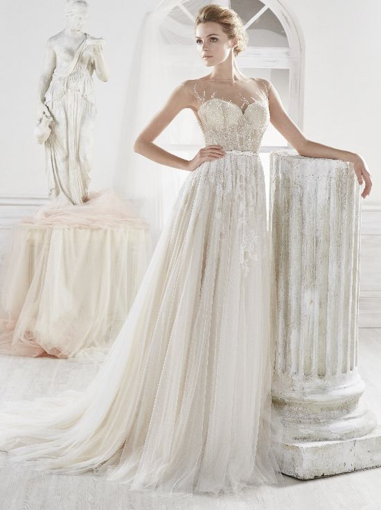 Bella is a wedding gown by Nicole Spose. She is a fully beaded A-line gown with an exquisite illusion neckline. #WeddingDresses#NicoleSpose #WeddingGownsPretoria