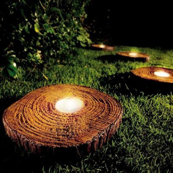 Lights in tree stump slices to illuminate yard
