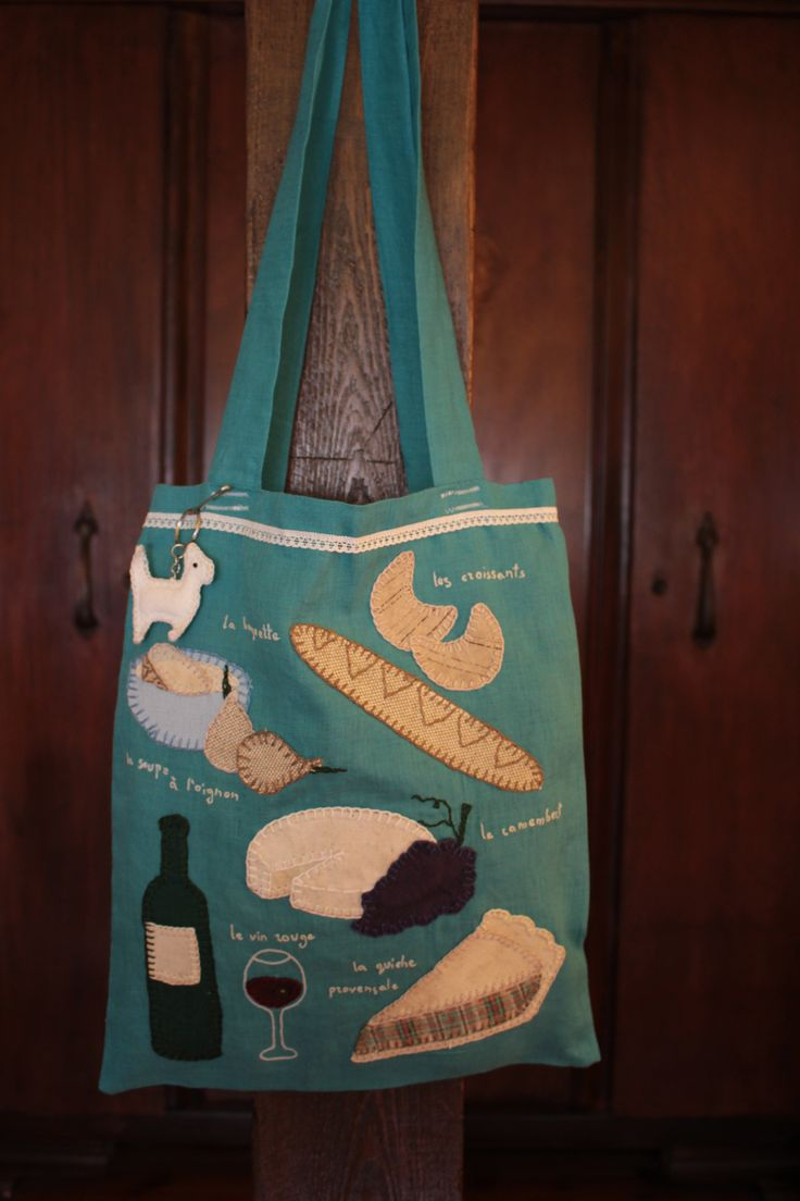 Hand made sewed bag with embroided inscriptions