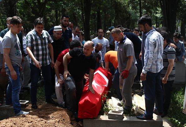 People bury the coffin of airport taxi driver Mustafa Biyikli who lost his life in the following yesterday's suicide bomb attack in Istanbul Ataturk...