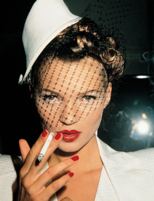 Kate Moss photographed by Roxanne Lowit backstage at Galliano (in Paris), 1994.