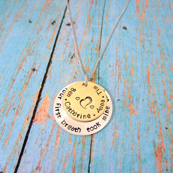 "This necklace is simple and can be worn with any outfit, dressed up or down. The bottom disc is sterling silver and measures 1"". The bottom disc says, ""your first breath took mine away"". The top disc can be made in either brass or gold filled, and measures 3/4th of an inch. The top disc is personalized with your children's names. This necklace hangs on a 20"" sterling silver chain, with sterling silver connecting pieces.   -------------------  Please type the names you would like on the top…"