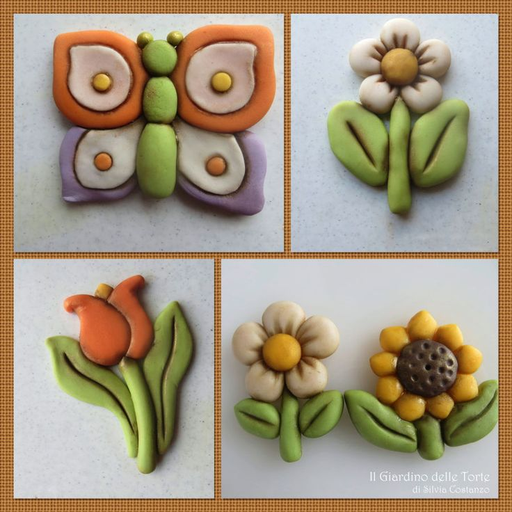 Tulip, daisy, sunflower and butterfly made with sugar paste. I hope you like it! :-)