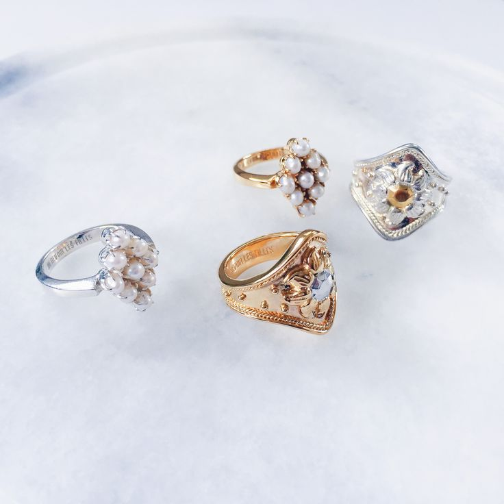 Gold and silver stacking rings with silver stars and golden suns. Beautiful rings to adorn and love. Finely crafted in sterling silver with 14k gold and fresh water pearls. Shop now at Au Revoir Les Filles