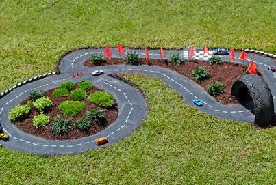 Mini race track - a great idea for the garden (if you have space for small version for sit in cars, that would be even better)