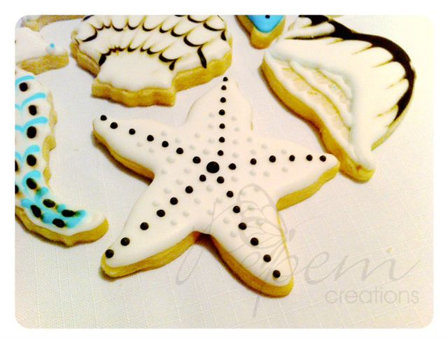 """Vanilla cookies with decorative almond icing and hand painted. Size 3 1/2"""""""