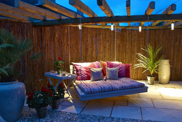 Love the holiday cottage - but love this hanging bed. Please can I have one of these in my garden.