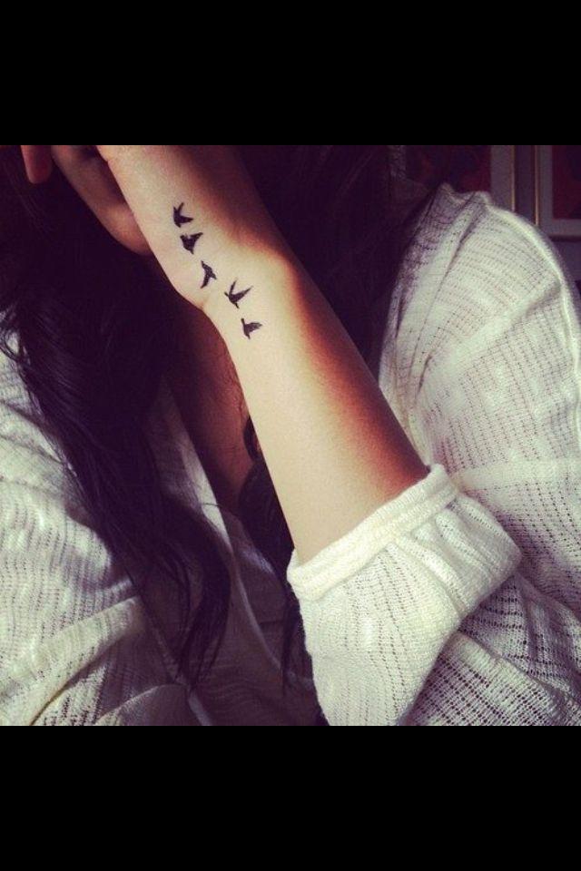 Bird tattoo on wrist