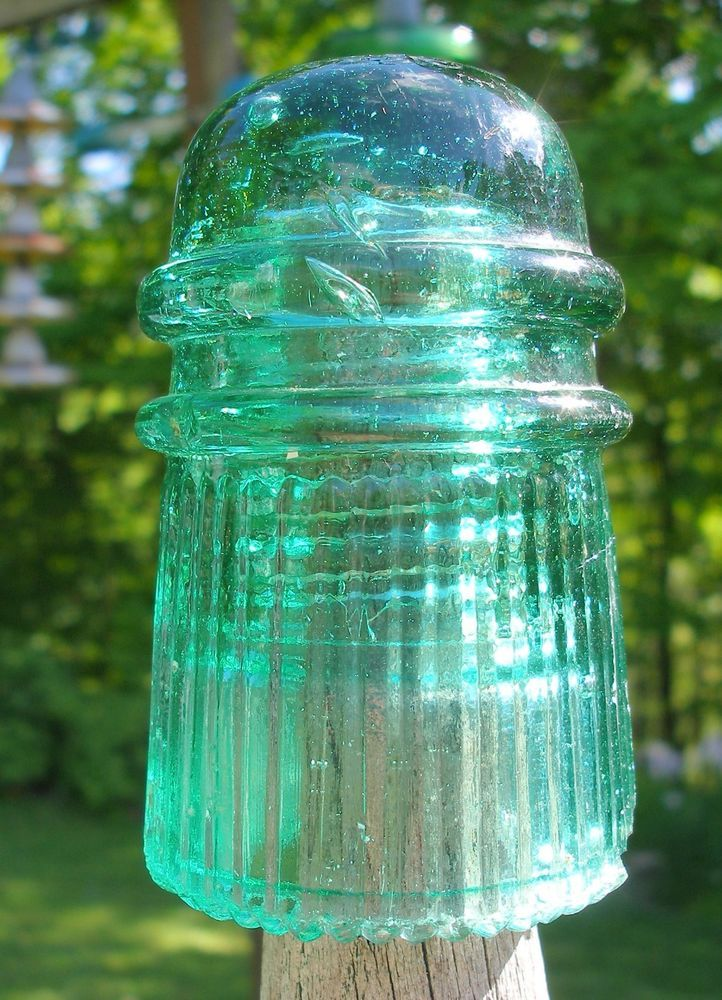 1322 best images about glass insulators on pinterest for Power line insulators glass