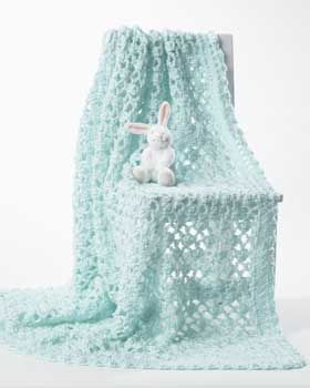 Lacy baby blanket that is sure to be a treasured heirloom for years to come. Shown in Bernat Softee Baby.