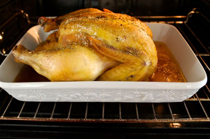 Slow Roasted Whole Chicken -- the oven temperature is really low and creates the juiciest chicken ever!