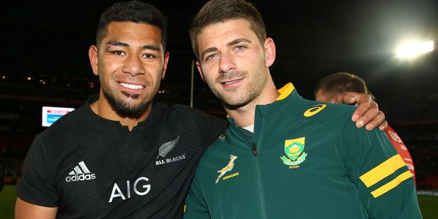 All Black Charles Piutau and Springbok Willie le Roux were among the rivals who mingled on the pitch at Ellis Park last weekend.  Photo / Getty Images
