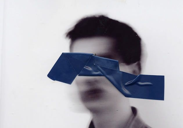This image was created in response to the topic 'Concealment'. A strip of folded tape was placed upon a blurred photograph and then scanned to create a subsequent digital image. This creates the illusion of a piece of tape floating in midair, in front of a ghost-like figure.