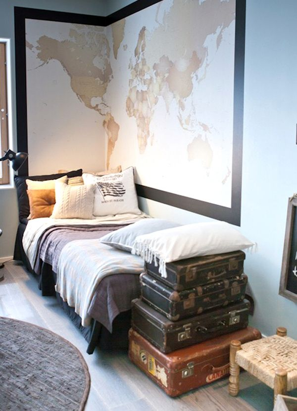 Map in the corner; like the tousled bed; the old suitcases.