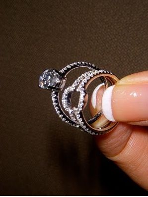Wedding band that wraps around the engagement ring to form a halo when put together