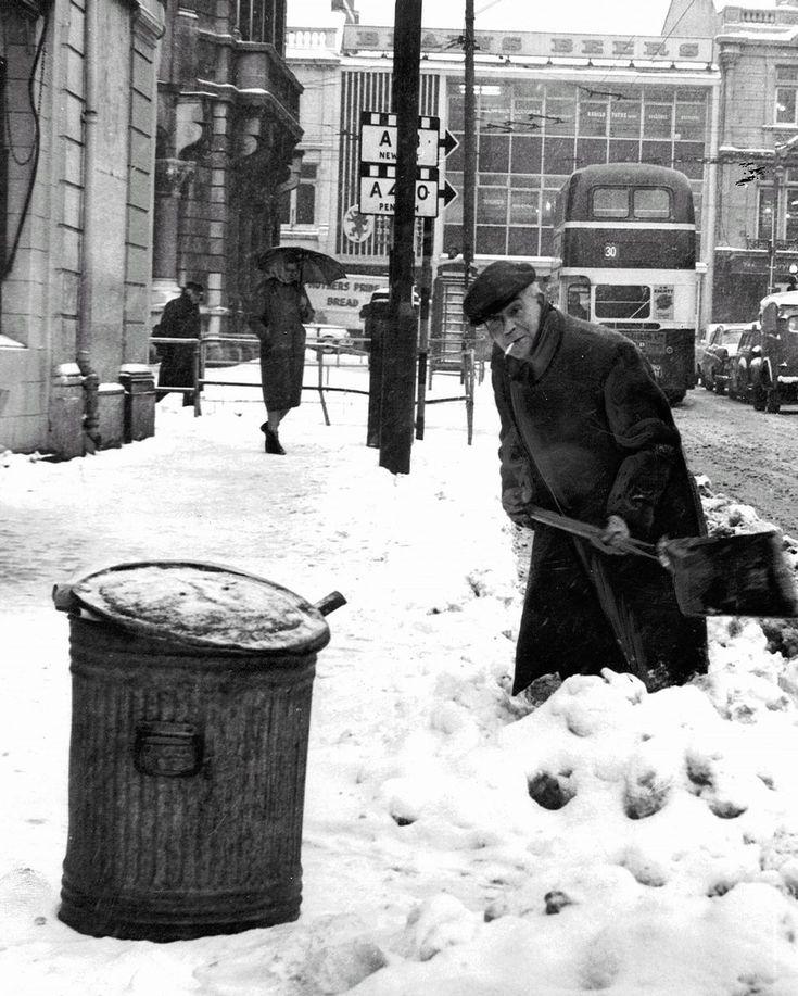 A man digs the snow away on Wood Street Cardiff, Feb 1963