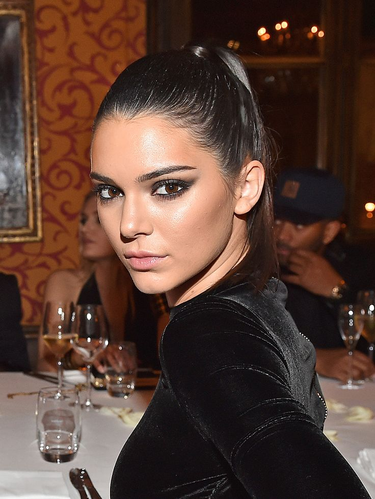Kendall Jenner looks super chic with a sleek pony and a dramatic smoky eye