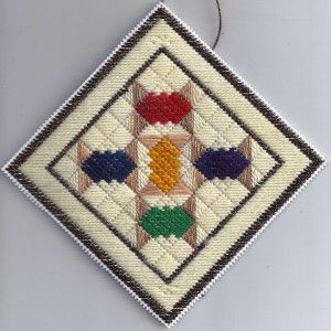 Plastic Canvas Needlepoint Spool Quilt Ornament, designed by needlepoint expert Janet M. Perry